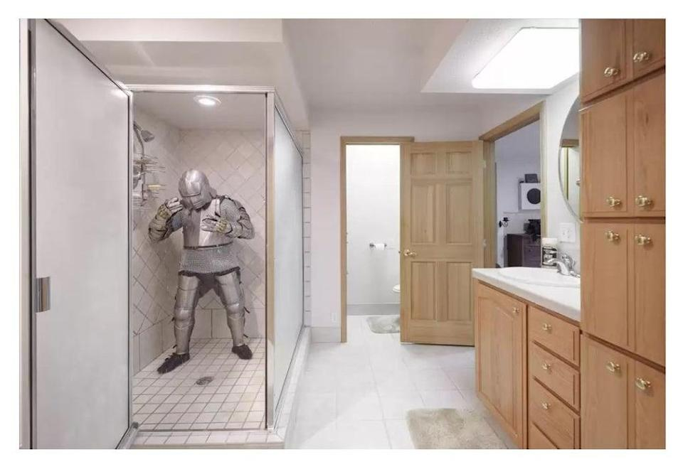 Let's hope his armour doesn't rust in this walk-in shower (REALTOR.COM)
