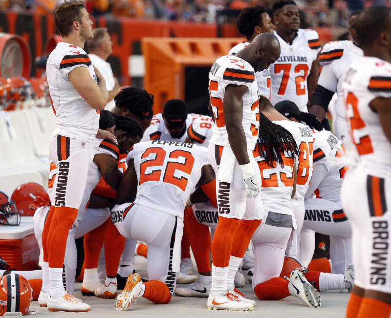 Cleveland Browns players kneel during a recent anthem. More