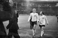 16th July 1966: Nobby Stiles and Bobby Moore chatting to each other during the England versus Mexico 1966 World Cup match. (Photo by Express/Express/Getty Images)
