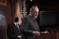 Senate Majority Leader Chuck Schumer, D-N.Y., joined at left by Sen. Dick Durbin, D-Ill., the majority whip, speaks at a news conference at the Capitol in Washington, Tuesday, Feb. 2, 2021. (AP Photo/J. Scott Applewhite)