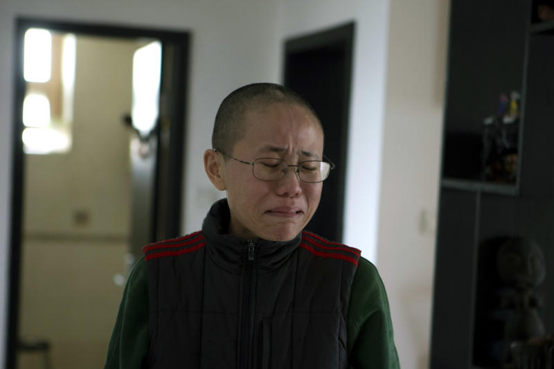 Liu Xia, wife of 2010 Nobel Peace Prize winner Liu Xiaobo, reacts emotionally to an unexpected visit by journalists from The Associated Press at her home in Beijing, China, on Thursday, Dec. 6, 2012. Liu trembled uncontrollably and cried Thursday as she described how her confinement under house arrest has been absurd and emotionally draining in the two years since her jailed activist husband was named a Nobel Peace laureate. (AP Photo/Ng Han Guan)