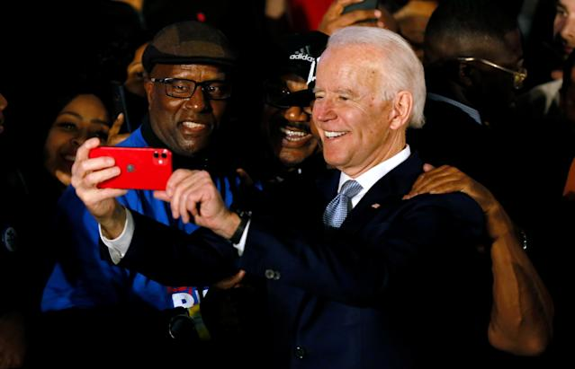 Former Vice President Joe Biden takes photos with supporters at his South Carolina primary night rally in Columbia, S.C. (Reuters/Elizabeth Frantz)