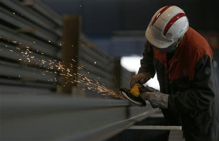 Sparks fly as an employee works on a rail at the Tata Steel rails factory in Hayange