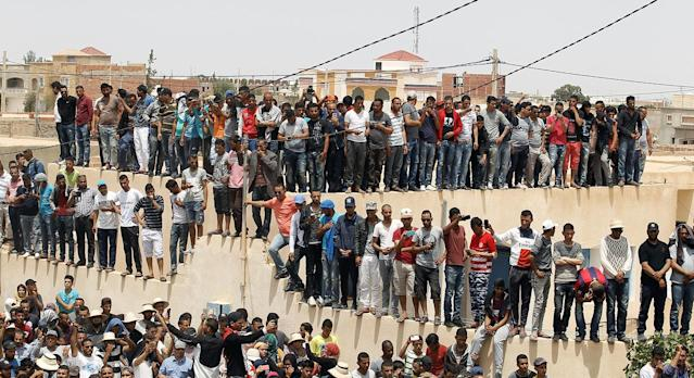 <p>Mourners gathers in front of the house of a dead man hit by a police vehicle on Monday at job demonstrations in Tatouine, Tunisia, May 23, 2017. (Photo: Zoubeir Souissi/Reuters) </p>
