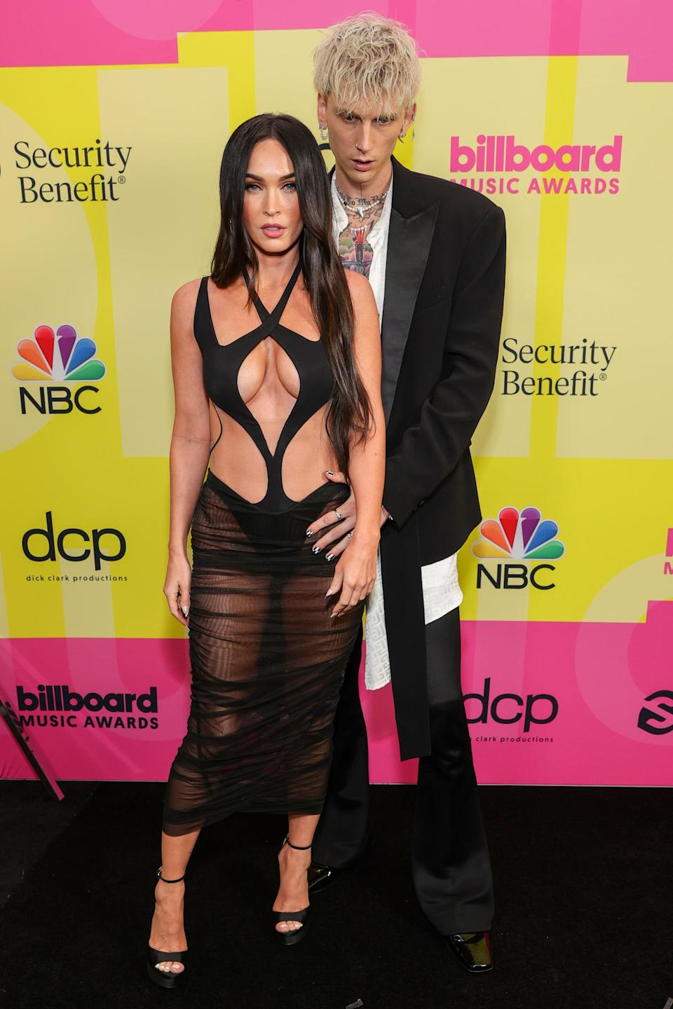 <p>Megan supported boyfriend Machine Gun Kelly at the 2021 Billboard Music Awards in a cutout Mugler gown with a mesh skirt. </p>