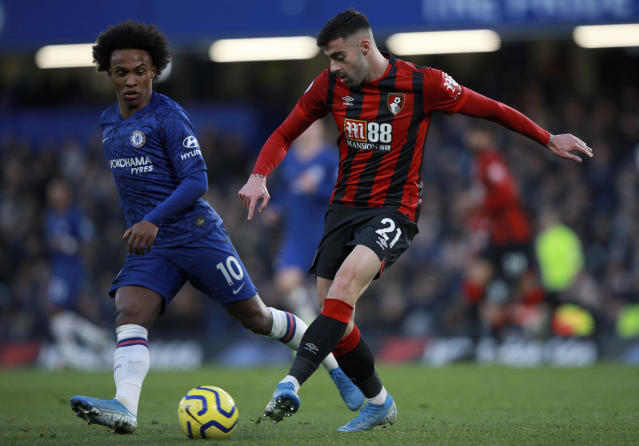 Bournemouth's Diego Rico, right, duels for the ball with Chelsea's Willian during the English Premier League soccer match between Chelsea and Bournemouth, at Stamford Bridge in London, Saturday, Dec. 14, 2019. (AP Photo/Ian Walton)