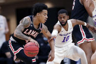 Lamar guard Kasen Harrison, left, drives around Abilene Christian guard Reggie Miller (10) during the first half of an NCAA college basketball game in the Southland Conference semifinals Friday, March 12, 2021, in Katy, Texas. (AP Photo/Michael Wyke)
