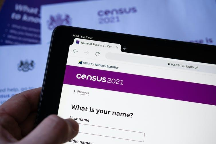 Person filling out 2021 online sensus form on a tablet