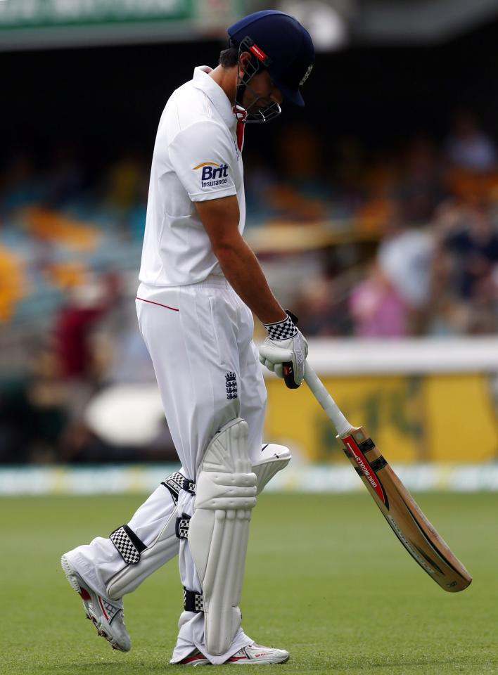 England's captain Alastair Cook walks off the field after his dismissal by Australia's Nathan Lyon during the fourth day's play of the first Ashes cricket test match in Brisbane November 24, 2013. REUTERS/David Gray (AUSTRALIA - Tags: SPORT CRICKET)