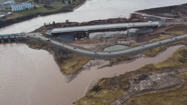 The completion of the bridge will require closing the causeway so the gate structure can be removed and ramps built to the bridge.  (Shane Fowler/CBC - image credit)