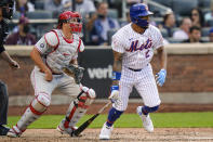 Philadelphia Phillies catcher J.T. Realmuto, second from left, watches the ball that New York Mets' Dominic Smith, right, hit for a walkoff RBI-single during the eighth inning of the first baseball game of a doubleheader Friday, June 25, 2021, in New York. (AP Photo/Frank Franklin II)