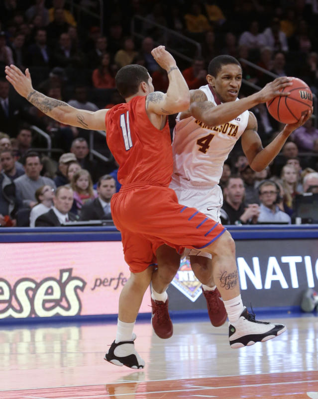 Minnesota's Deandre Mathieu (4) runs into SMU's Nic Moore (11) during the first half of an NCAA college basketball game in the final of the NIT, Thursday, April 3, 2014, in New York. (AP Photo/Frank Franklin II)