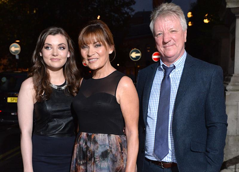 Lorraine Kelly with her daughter Rosie and husband Steve Smith in 2014 (AP)
