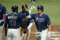 Tampa Bay Rays' Hunter Renfroe celebrates with teammates, including Manuel Margot (13), after Renfroe hit a grand slam off Toronto Blue Jays starting pitcher Hyun-Jin Ryu during the second inning of Game 2 of an American League wild-card baseball series Wednesday, Sept. 30, 2020, in St. Petersburg, Fla. (AP Photo/Chris O'Meara)