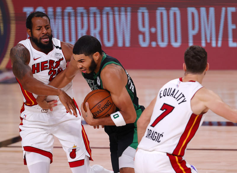 LAKE BUENA VISTA, FLORIDA - SEPTEMBER 25: Jayson Tatum #0 of the Boston Celtics drives the ball against Andre Iguodala #28 of the Miami Heat during the second quarter in Game Five of the Eastern Conference Finals during the 2020 NBA Playoffs at AdventHealth Arena at the ESPN Wide World Of Sports Complex on September 25, 2020 in Lake Buena Vista, Florida. NOTE TO USER: User expressly acknowledges and agrees that, by downloading and or using this photograph, User is consenting to the terms and conditions of the Getty Images License Agreement. (Photo by Mike Ehrmann/Getty Images)