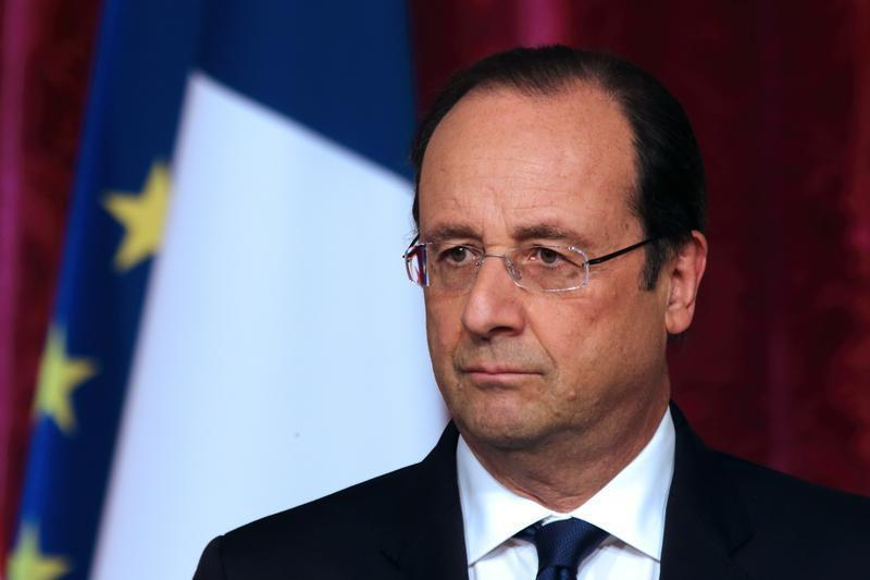 French President Hollande pauses as he attends a news conference at the Elysee Palace in Paris