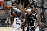 Utah Jazz guard Donovan Mitchell, left, shoots as Los Angeles Clippers forward Nicolas Batum, right, and guard Terance Mann defend during the second half of Game 3 of a second-round NBA basketball playoff series Saturday, June 12, 2021, in Los Angeles. (AP Photo/Mark J. Terrill)
