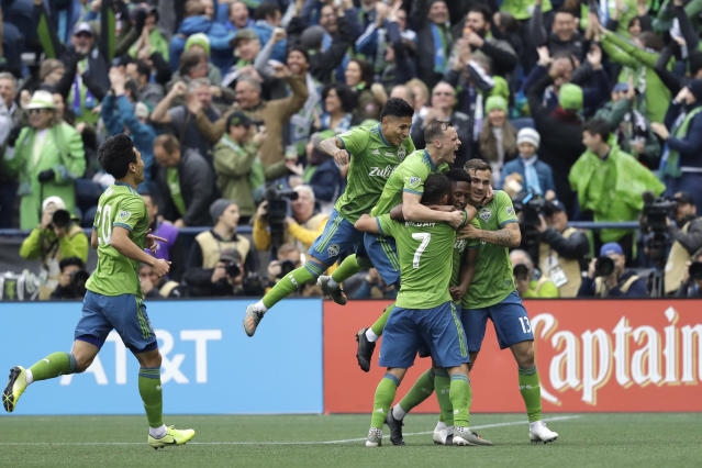Seattle Sounders' Kelvin Leerdam, second right, is mobbed by teammates after he scored against Toronto FC during the second half of the MLS Cup championship soccer match Sunday, Nov. 10, 2019, in Seattle. The Sounders won 3-1. (AP Photo/Elaine Thompson)