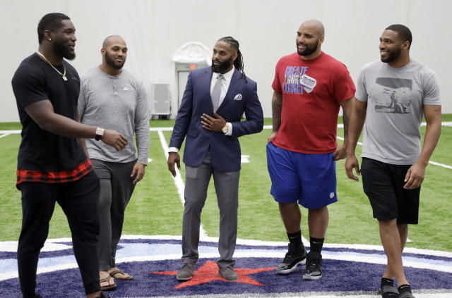 Former Tennessee Titans safety Michael Griffin, center, talks with former teammates after Griffin signed a one-day contract with the team and then retired as a Titan Monday, May 7, 2018, in Nashville, Tenn. Griffin, a first-round pick by the Titans in 2007, played nine seasons for Tennessee. From left are outside linebacker Brian Orakpo, defensive end Jurrell Casey, Griffin, defensive end DaQuan Jones, and inside linebacker Wesley Woodyard. (AP Photo/Mark Humphrey)