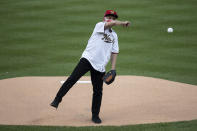 Dr. Anthony Fauci, director of the National Institute of Allergy and Infectious Diseases, throws out a ceremonial first pitch before an opening day baseball game between the Washington Nationals and the New York Yankees at Nationals Park, Thursday, July 23, 2020, in Washington. (AP Photo/Alex Brandon)