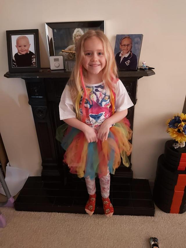 Amellie Barrett is in self-isolation but dressed up in rainbow colours and waved to classmates from her bedroom window