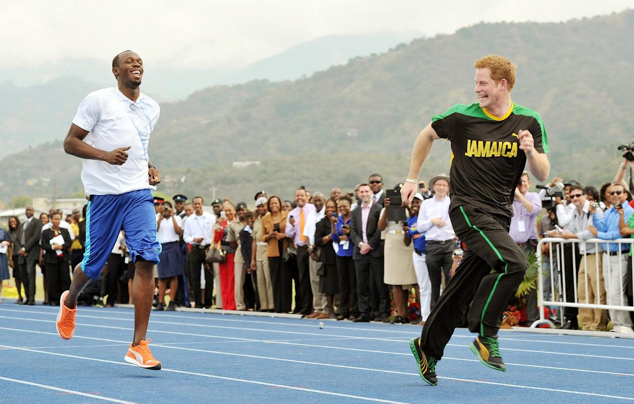 Britain's Prince Harry is first out of the blocks against Olympic sprint champion Usain Bolt, Tuesday March 6 2012 at a mock race at the University of the West Indies, in Jamaica. Harry is touring the Caribbean as part of a Diamond Jubilee tour in honor of Queen Elizabeth II as she celebrates 60 years on the throne. His visit comes as the new prime minister, Portia Simpson Miller, has called anew for the severing of ties with the British monarchy. (AP PhotoJohn Stillwell/PA) UNITED KINGDOM OUT NO SALES NO ARCHIVE