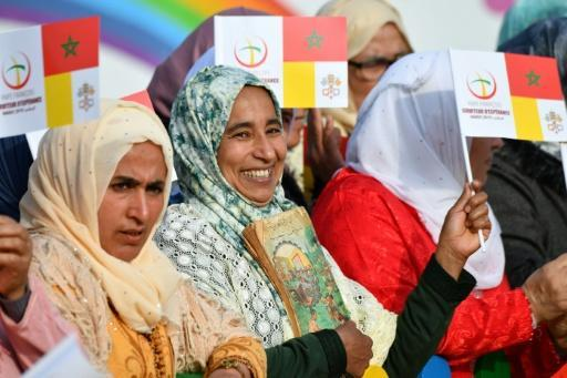 Crowds gather outside a social centre near Rabat, which Pope Francis visited on Sunday
