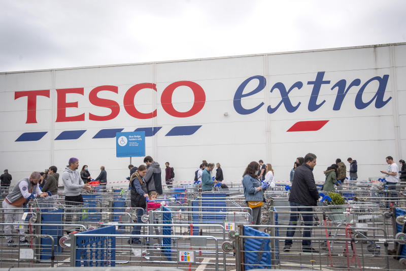 A long queue maintaining social distancing outside a Tesco supermarket in north London as the UK continues in lockdown to help curb the spread of the coronavirus. (Photo by Victoria Jones/PA Images via Getty Images)