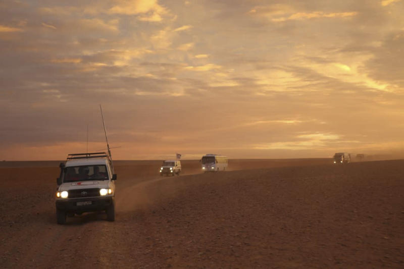 FILE - In this Nov. 4, 2018 file photo, released by the Syrian Arab Red Crescent, shows a convoy of vehicles of the Syrian Arab Red Crescent driving in the Syrian desert heading to Rukban camp between the Jordan and Syria borders. The U.S. military said Monday, April, 8, 2019 that it is not preventing Syrians from leaving the remote Rukban camp near an American base in Syria and is urging Russia and Damascus to help facilitate the delivery of humanitarian aid. Russia has recently called for the camp to be dismantled and accused the U.S. of hindering such efforts. (Syrian Arab Red Crescent via AP, File)