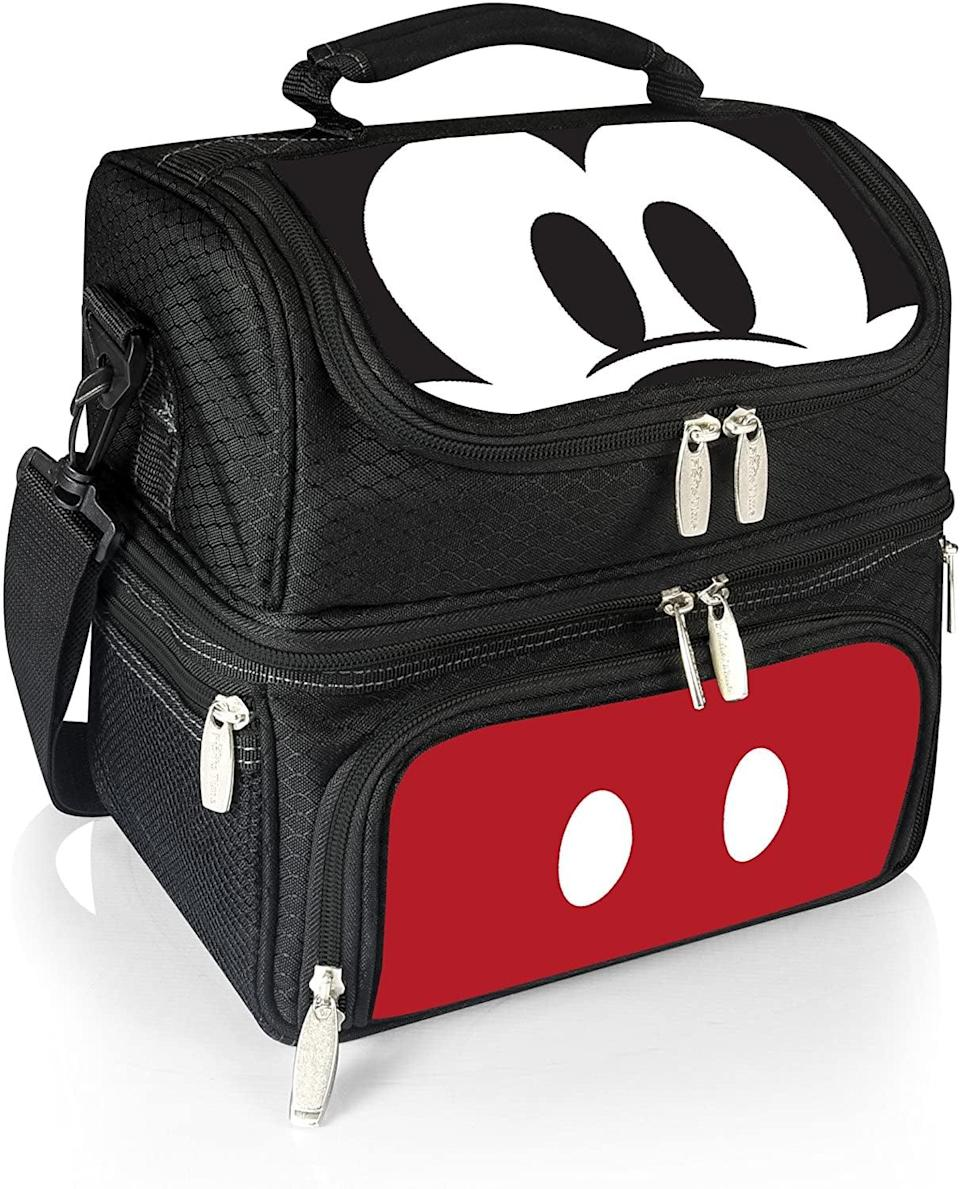 <p>Enjoy your favorite snacks and drinks on the beach or by the poolside with this <span>Picnic Time Pranzo Insulated Lunch Tote, 12 Inch, Mickey Mouse</span> ($75).</p>