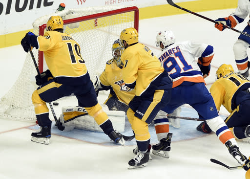 "<a class=""link rapid-noclick-resp"" href=""/nhl/teams/nyi/"" data-ylk=""slk:New York Islanders"">New York Islanders</a> centre <a class=""link rapid-noclick-resp"" href=""/nhl/players/4681/"" data-ylk=""slk:John Tavares"">John Tavares</a> had a natural hat-trick in 7:14 against the <a class=""link rapid-noclick-resp"" href=""/nhl/teams/nas/"" data-ylk=""slk:Nashville Predators"">Nashville Predators</a> on Saturday night. (AP Photo/Mark Zaleski)"