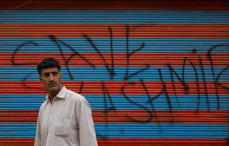 Kashmiri man waits before Eid-al-Adha prayers during restrictions after the scrapping of the special constitutional status for Kashmir by the Indian government, in Srinagar