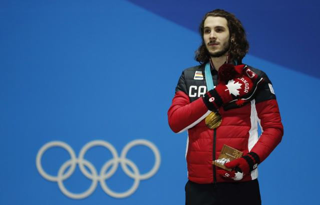 Medals Ceremony - Short Track Speed Skating Events - Pyeongchang 2018 Winter Olympics - Men's 1000m - Medals Plaza - Pyeongchang, South Korea - February 18, 2018 - Gold medalist Samuel Girard of Canada on the podium. REUTERS/Eric Gaillard