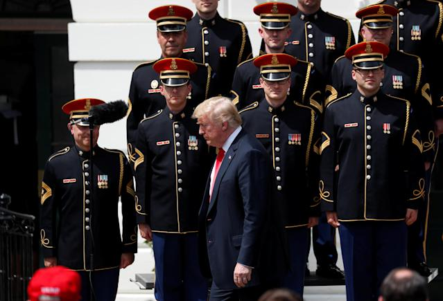 "U.S. President Donald Trump departs his ""celebration of America"" event past the United States Army Chorus on the South Lawn of the White House in Washington, U.S., June 5, 2018. The event was arranged after Trump canceled the planned visit of the Super Bowl champion Philadelphia Eagles to the White House. REUTERS/Kevin Lamarque"
