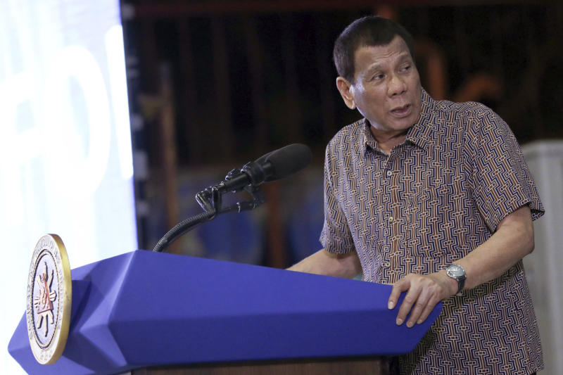 In this Jan. 23, 2020, photo provided by the Malacanang Presidential Photographers Division, Philippine President Rodrigo Duterte delivers his speech at the San Isidro Central School during the distribution of benefits to former rebels in Leyte province, southern Philippines. (Karl Norman Alonzo/Malacanang Presidential Photographers Division via AP)