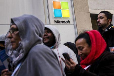 Shoppers stand in line to wait for the grand opening of a flagship Microsoft Corp. retail store in New York