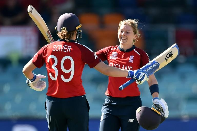 Ton up: England's Heather Knight (right) is congratulated by Natalie Sciver after reaching her century