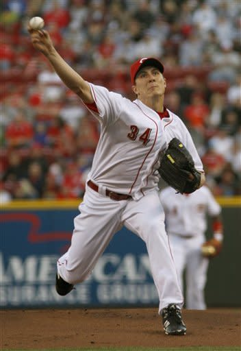 Cincinnati Reds pitcher Homer Bailey throws against the St. Louis Cardinals during the first inning of an MLB baseball game, Monday, April 9, 2012, in Cincinnati. (AP Photo/David Kohl)