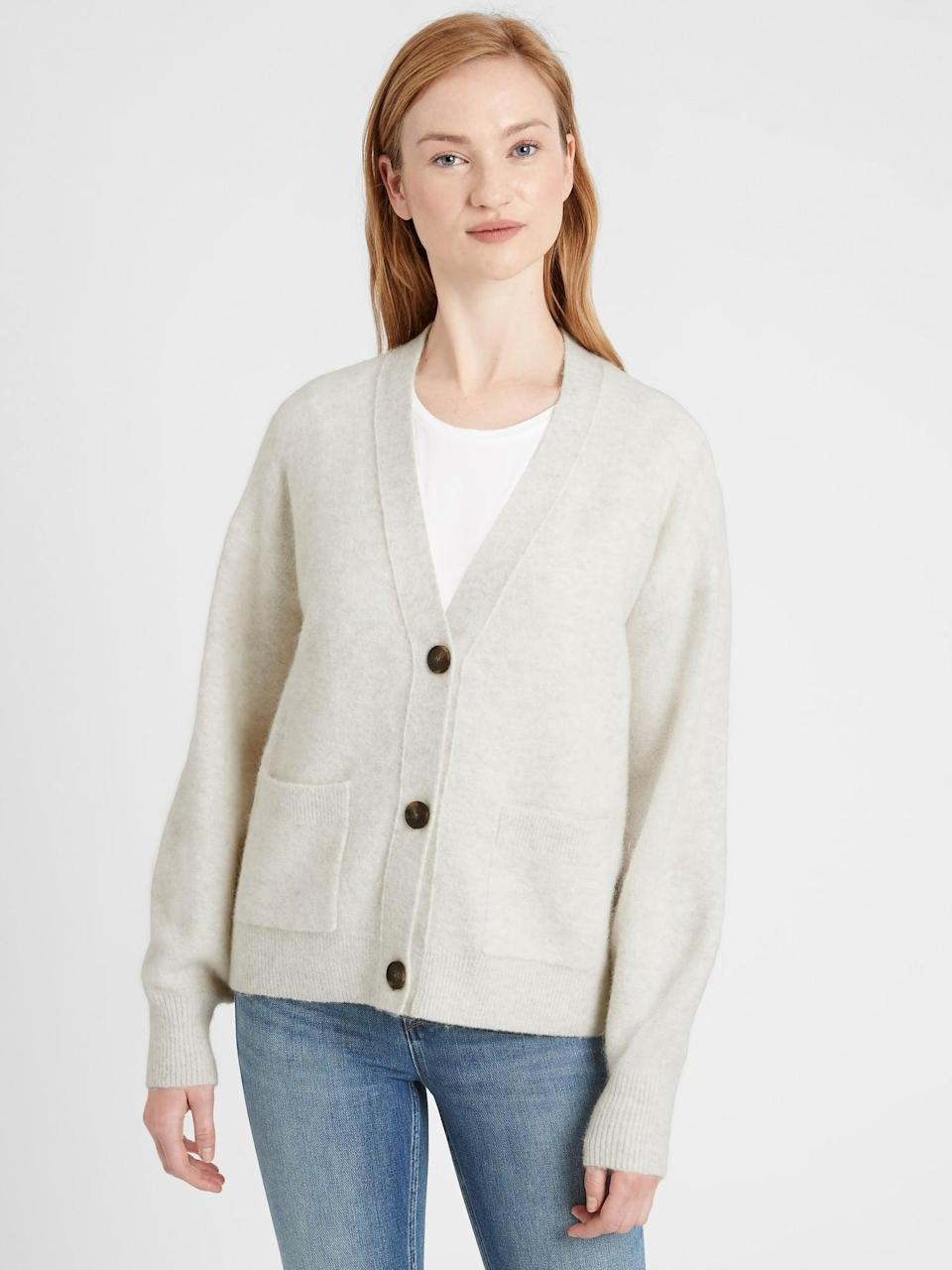 <p>Layer this <span>Oversized Blouson-Sleeve Cardigan Sweater</span> ($59, originally $99) over a classic tee.</p>