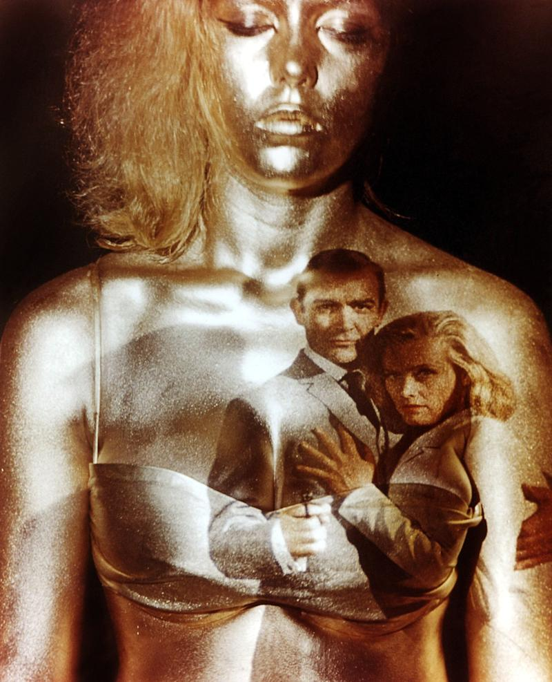 Margaret Nolan as the gold-painted backdrop for the opening title sequence of Goldfinger - Moviestore/Shutterstock
