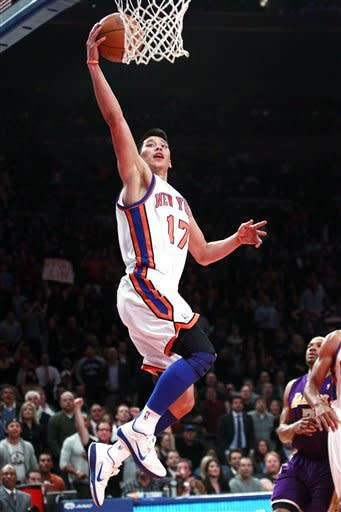 New York Knicks' Jeremy Lin (17) drives past Los Angeles Lakers' Derek Fisher during the first half of an NBA basketball game, Friday, Feb. 10, 2012, in New York. (AP Photo/Frank Franklin II)