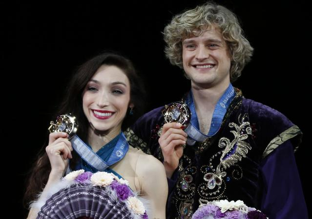 Gold medallists Meryl Davis and Charlie White of the U.S. pose during the award ceremony for the ice dance competition at the ISU Grand Prix of Figure Skating Final in Fukuoka, southwestern Japan in this file photo from December 7, 2013. REUTERS/Issei Kato/Files (JAPAN - Tags: SPORT FIGURE SKATING OLYMPICS)