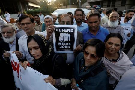 FILE PHOTO: Journalists chant slogans during a rally protest which they say is against layoffs and the non-payment of salaries, in Karachi