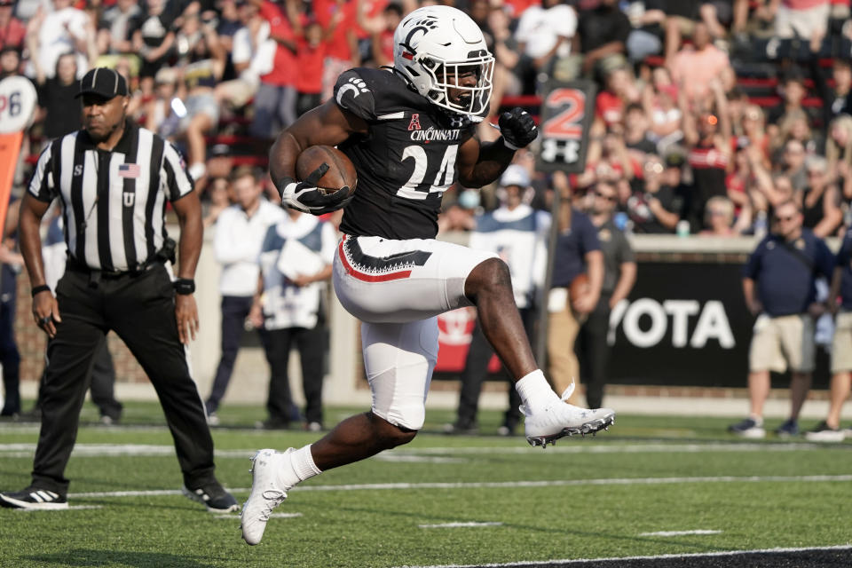 Cincinnati running back Jerome Ford (24) runs into the end zone for a touchdown during the second half of an NCAA college football game against Murray State, Saturday, Sept. 11, 2021, in Cincinnati. (AP Photo/Jeff Dean)