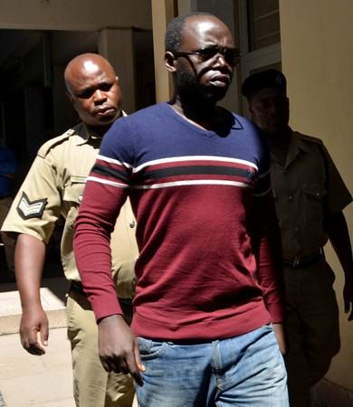 Tanzanian investigative journalist Erick Kabendera arrives at the Kisutu Residents Magistrate Court in Dar es Salaam
