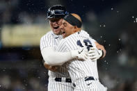 New York Yankees Luke Voit celebrates with Yankees Rougned Odor after hitting a ninth-inning, walk-off RBI single to defeat the Kansas City Royals 6-5 in a baseball game, Wednesday, June 23, 2021, at Yankee Stadium in New York. (AP Photo/Kathy Willens)