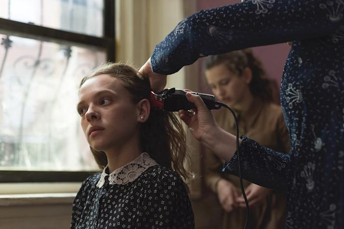 """Newlywed Esty (Shira Haas) has her head shaved in a scene from """"Unorthodox."""" <span class=""""copyright"""">(Anika Molnar / Netflix)</span>"""