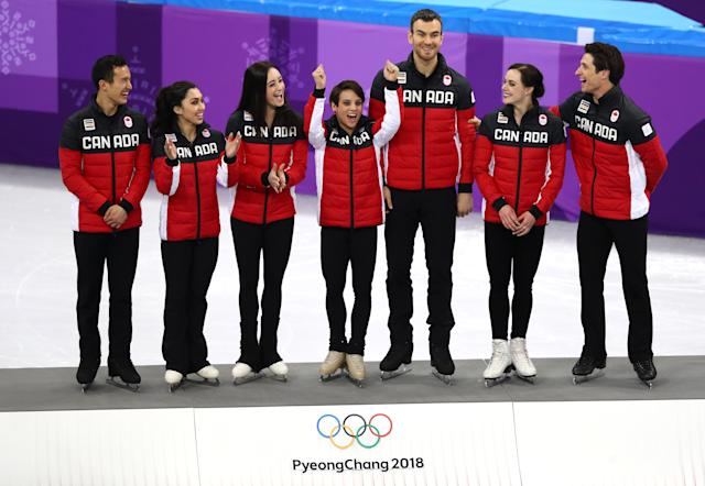 <p>Gold medalists Team Canada celebrate on the podium in the victory ceremony after the Figure Skating Team Event. The Olympic Athletes from Russia won silver and the USA won bronze. </p>