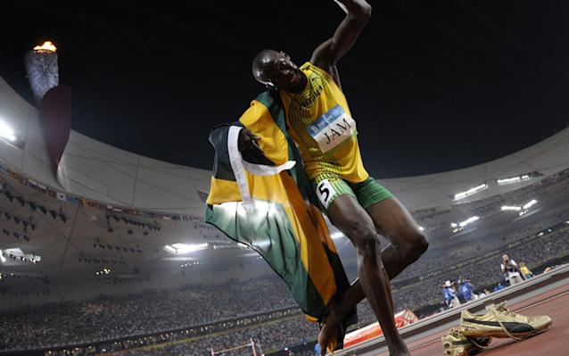 Usain Bolt celebrating winning the men's 4x100m race in Rio last summer - AFP