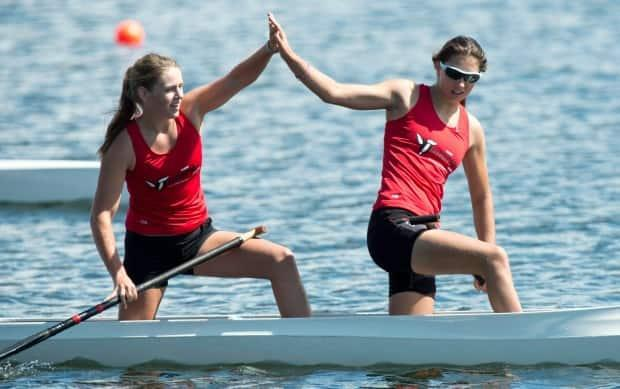 Canada's Katie Vincent, right, seen above in 2013, earned a spot on the coutnry's sprint canoe team for the upcoming Tokyo Olympics on Friday. (Paul Chiasson/The Canadian Press - image credit)